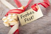 Golden label with Frohes Fest — Stock Photo