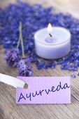 Ayurveda on a purple label — Stock Photo