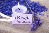 Kraft tanken on a purple label — Stock Photo