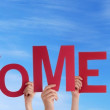 Hands Holding Welcome Back in the Sky — Stock Photo #30721813