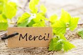 Label With Merci — Stock Photo