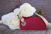 Empty Red Tag with Roses — Stock Photo