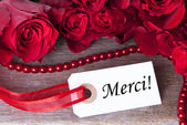 Rosy Background with Merci — Stock Photo