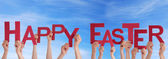 Happy Easter in front of the Sky — Stock Photo