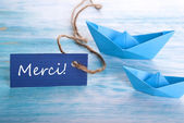 Label with Merci and Boats — Stock Photo