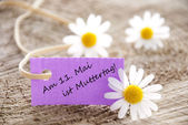 Purple Label with Am 11 Mai ist Muttertag — Stock Photo