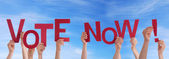 Hands Holding Vote Now in the Sky — Stock Photo