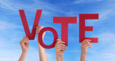 Hands Holding Vote in the Sky — Stock Photo