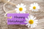 Paarse label met gelukkige vakantie — Stockfoto