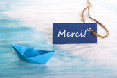 Blue Tag with Merci — Stock Photo