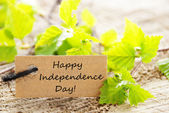 Label with Leaves and Happy Independence Day — Stock Photo