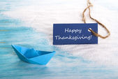 Blue Label with Happy Thanksgiving at the Beach — Stock Photo