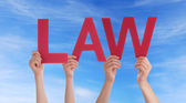 People Holding Law in the Sky — Stock Photo