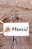 Merci Label on Wood — Stock Photo