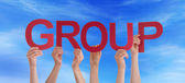 Many People Holding Group in the Sky — Stockfoto