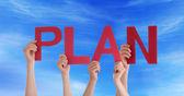 People Holding Plan in the Sky — Zdjęcie stockowe