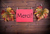Merci on a Red Label — Stock Photo
