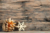 Fir Cone and Snowflake — Stock Photo