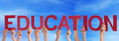 People Holding Education in the Sky — Stock Photo