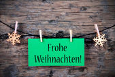 Green Tag with Frohe Weihnachten — Stock Photo