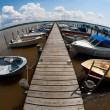 Harbour and boats at a long jetty photographed with fisheye — Stock Photo #15277497