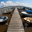 Harbour and boats at a long jetty photographed with fisheye — Stock Photo