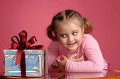 Child with a gift — Stock Photo