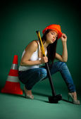 Young woman with a sledgehammer — Stock Photo