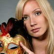Beautiful blond in venetian mask with feathers — Stock Photo