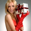 Beautiful blond holding gift box. — Stock Photo #19412211