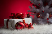 Red ball and gift — Stock Photo
