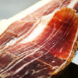 "Cut of a typical ""Jamon Iberico"" - Stock Photo"