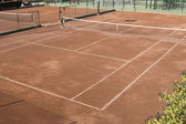 Clay surface tennis court. Dirt surface tennis court — Stock Photo