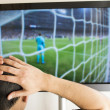 Man lamenting watching a football match — Stock Photo