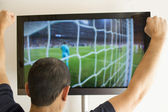 Man watching a football match — Stock Photo