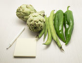 Pen Notebook and Fresh Vegetables — Stock Photo