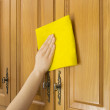 Young woman in the Kitchen doing Housework cleaning cupboards — Stock Photo