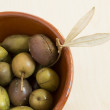 Stock Photo: Green spanish olives in ceramic container in close up