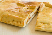 A bread pie filled with tunna and vegetables - empanada gallega — Stock Photo