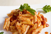 Penne pasta with a sauce — Stock Photo
