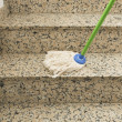 Mop cleaning the stairs marble — Stock Photo