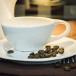 Wonderful cup of coffee with coffee beans on plate — Stock Photo #23868213