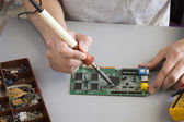 Welding process of a resistor on a electronic board. — Stock Photo