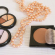 Stock Photo: Cosmetics and pearls background
