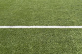 Close up of soccer field with single line and copy space — Стоковое фото