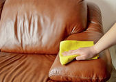 Hand wiping couch brown — Stock Photo