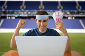 Online betting gaining euros in stadium — Stock Photo