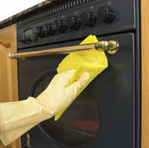 Cleaning the outside of an oven — Stock Photo