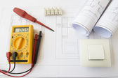 Plans and electrical tools — Stock Photo
