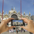 Tourist holds up camera phone at  the Basilica of San Marco in v — Stock Photo